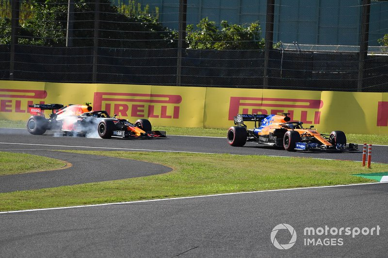 Carlos Sainz Jr., McLaren MCL34, leads Alex Albon, Red Bull RB15