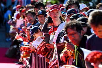 Fans wait for drivers to signs autographs