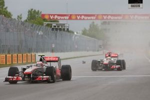 Jenson Button, McLaren MP4-26 Mercedes, leads Lewis Hamilton, McLaren MP4-26 Mercedes