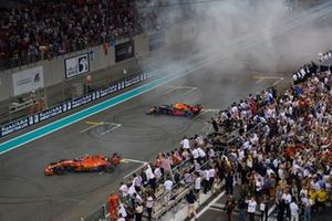 Charles Leclerc, Ferrari SF90 and Max Verstappen, Red Bull Racing RB15, 2nd position, celebrate with donuts
