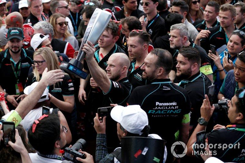 The Jaguar team celebrate at the podium