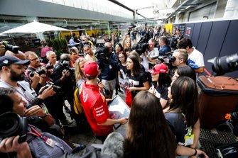 Sebastian Vettel, Ferrari with fans in the paddck
