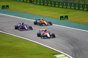 Kimi Raikkonen, Alfa Romeo Racing C38, Daniil Kvyat, Toro Rosso STR14 and Lando Norris, McLaren MCL34