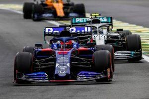 Daniil Kvyat, Toro Rosso STR14, leads Valtteri Bottas, Mercedes AMG W10