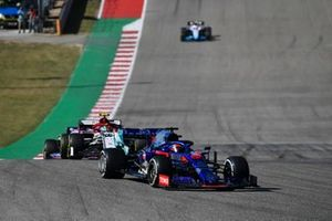 Daniil Kvyat, Toro Rosso STR14, leads Antonio Giovinazzi, Alfa Romeo Racing C38, and Lance Stroll, Racing Point RP19