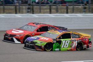 Kyle Busch, Joe Gibbs Racing, Toyota Camry M&M's Halloween and Bubba Wallace, 23XI Racing, Toyota Camry Door Dash