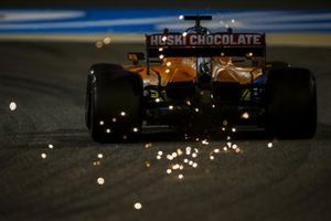 Sparks fly from the rear of Carlos Sainz Jr., McLaren MCL35