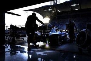 Mechanics push Valtteri Bottas' Mercedes F1 W11 into the pitlane