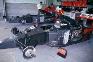 A McLaren MP4-6 Honda in the garage without bodywork