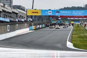 The grid forms behind the Safety Car