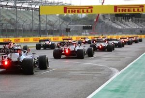 The drivers line up for the start