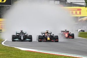 Lewis Hamilton, Mercedes W12 and Max Verstappen, Red Bull Racing RB16B battle at the start of the race