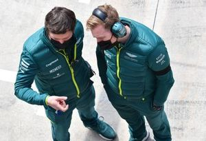 Aston Martin engineers in the pit lane