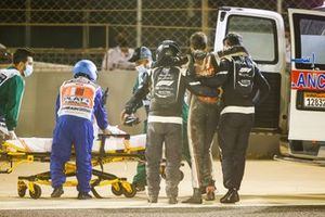 Romain Grosjean, Haas F1, is taken to a stretcher after his opening lap crash