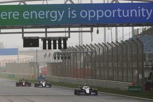 Mick Schumacher, Haas VF-21, Kimi Raikkonen, Alfa Romeo Racing C41 and Max Verstappen, Red Bull Racing RB16B