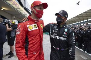 Sebastian Vettel, Ferrari, congratulates Lewis Hamilton, Mercedes-AMG F1, after winning his 7th championship