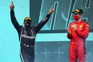 Lewis Hamilton, Mercedes-AMG F1, 1st position, and Sebastian Vettel, Ferrari, 3rd position, on the podium