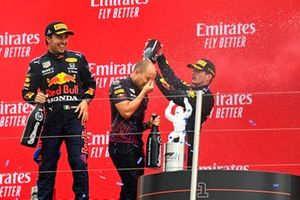 Sergio Perez, Red Bull Racing, 3rd position, Gianpiero Lambiase, Race Engineer, Red Bull Racing, and Max Verstappen, Red Bull Racing, 1st position, celebrate with Champagne on the podium
