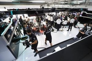 The Mercedes team at wok in the garage