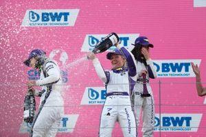 Jamie Chadwick, 1st position, Emma Kimilainen, 3rd position, and Irina Sidorkova, 2nd position, on the podium