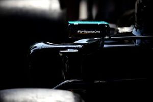 We Race As One logo on the mirror of the car of Lewis Hamilton, Mercedes W12