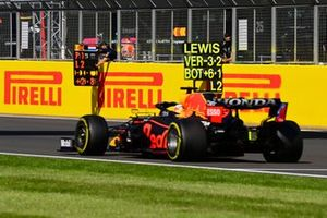 Max Verstappen, Red Bull Racing RB16B, passes his pit board