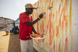 An artist demonstrates his work on the Eco Zone Legacy Project visit