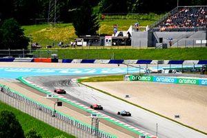 Carlos Sainz Jr., Ferrari SF21, Charles Leclerc, Ferrari SF21, and Fernando Alonso, Alpine A521