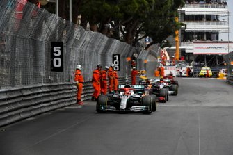 Marshal on track whilst Lewis Hamilton, Mercedes AMG F1 W10 and Pierre Gasly, Red Bull Racing RB15 drive past
