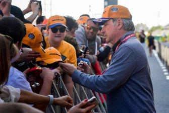 Carlos Sainz Sr signs autographs for fans