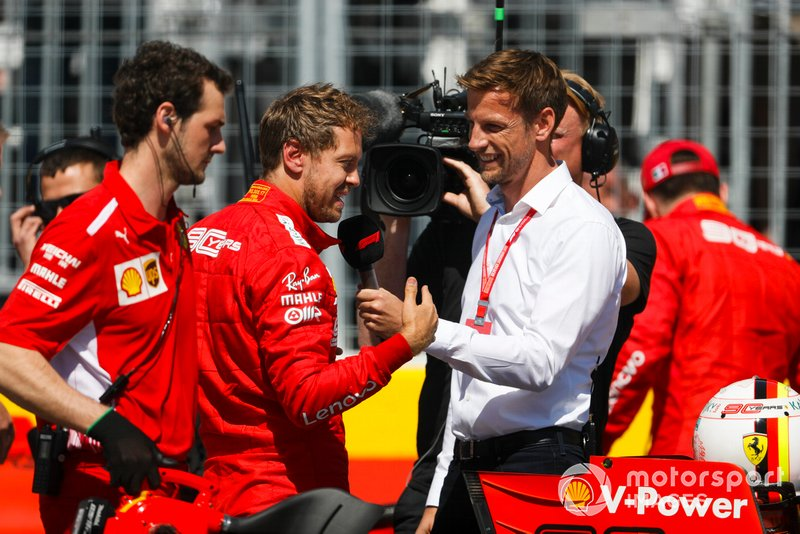 Pole man Sebastian Vettel, Ferrari, is interviewed by Jenson Button, Sky Sports F1, after Qualifying