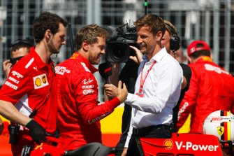 Pole man Sebastian Vettel, Ferrari, is interviewed by Jenson Button, Sky Sports F1, after Qualifying