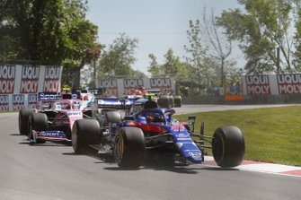 Alexander Albon, Toro Rosso STR14, with missing front wing, leads Lance Stroll, Racing Point RP19