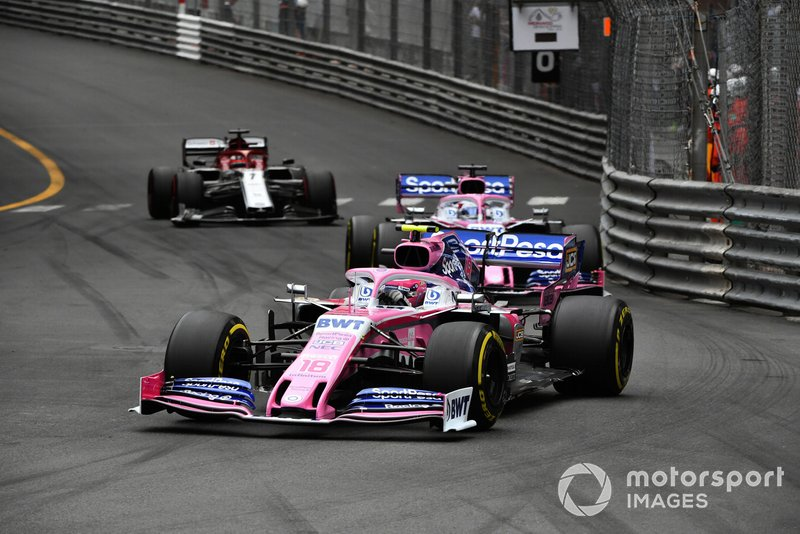 Lance Stroll, Racing Point RP19, leads Sergio Perez, Racing Point RP19, and Kimi Raikkonen, Alfa Romeo Racing C38
