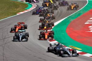Lewis Hamilton, Mercedes AMG F1 W10, leads Valtteri Bottas, Mercedes AMG W10, Sebastian Vettel, Ferrari SF90,Max Verstappen, Red Bull Racing RB15, Charles Leclerc, Ferrari SF90, and the rest of the field in the first corner