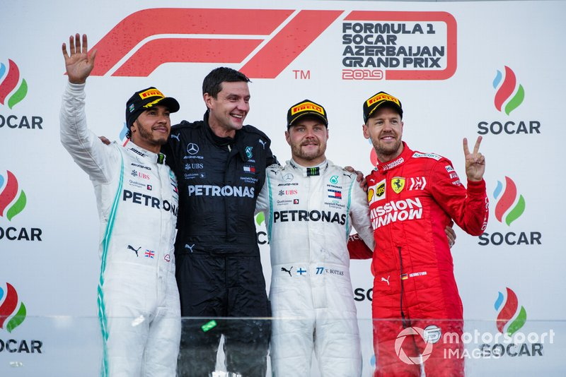 Lewis Hamilton, Mercedes AMG F1, 2nd position, the Mercedes Constructors trophy recipient, Valtteri Bottas, Mercedes AMG F1, 1st position, and Sebastian Vettel, Ferrari, 3rd position, on the podium