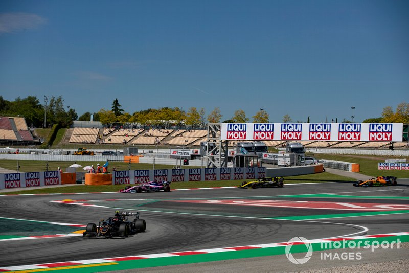 Kevin Magnussen, Haas F1 Team VF-19, leads Lance Stroll, Racing Point RP19, and Daniel Ricciardo, Renault R.S.19