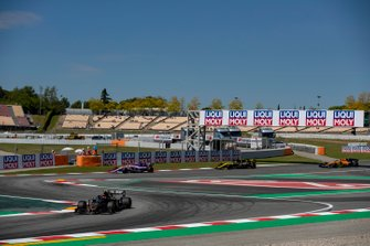 Kevin Magnussen, Haas F1 Team VF-19, leads Lance Stroll, Racing Point RP19, and Daniel Ricciardo, Renault R.S.19