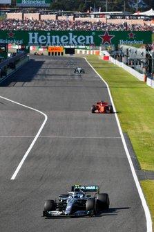 Valtteri Bottas, Mercedes AMG W10, leads Sebastian Vettel, Ferrari SF90, and Lewis Hamilton, Mercedes AMG F1 W10