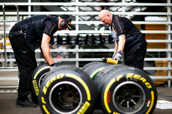 Pirelli technicians work on some tyres
