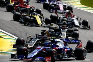Pierre Gasly, Toro Rosso STR14, leads Romain Grosjean, Haas F1 Team VF-19, Kevin Magnussen, Haas F1 Team VF-19, Antonio Giovinazzi, Alfa Romeo Racing C38, Daniel Ricciardo, Renault F1 Team R.S.19, and the remainder of the field through the first corners