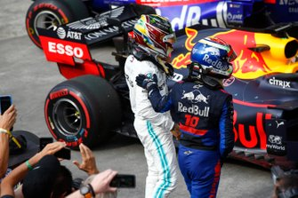 Lewis Hamilton, Mercedes AMG F1, 3rd position, and Pierre Gasly, Toro Rosso, 2nd position, in Parc Ferme