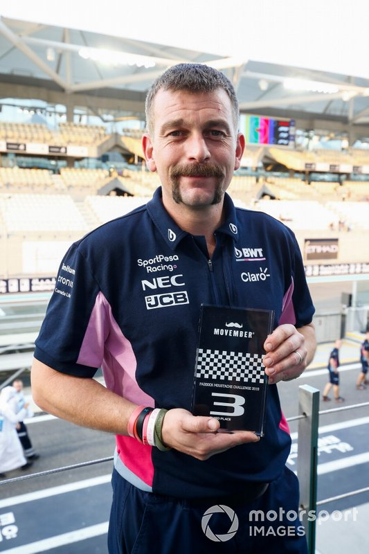 A Movember prize is awarded to a Racing Point team member