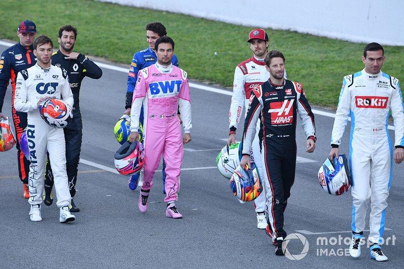 Pierre Gasly, AlphaTauri, Sergio Perez, Racing Point, Antonio Giovinazzi, Alfa Romeo, Romain Grosjean, Haas F1 and Nicholas Latifi, Williams Racing walk along the track