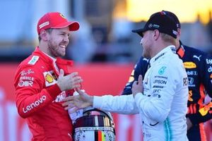 Sebastian Vettel, Ferrari, congratulates Valtteri Bottas, Mercedes AMG F1