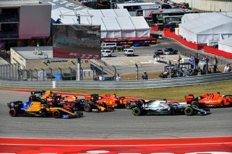 Sebastian Vettel, Ferrari SF90, leads Lewis Hamilton, Mercedes AMG F1 W10, Charles Leclerc, Ferrari SF90, Alex Albon, Red Bull Racing RB15, Carlos Sainz Jr., McLaren MCL34, and Lando Norris, McLaren MCL34, at the start