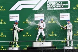 Phillip Sager, Dinamic Motorsport, 2nd position, Stephane Denoual, Pierre martinet by Almeras, 1st position, and Roar Lindland, Pierre martinet by Almeras, 3rd position, spray Champagne on the podium