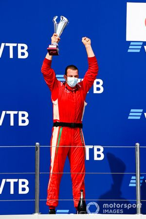 Winning Constructor Representative celebrates on the podium