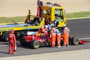 Marhals load the car of Sebastian Vettel, Ferrari SF1000, onto a truck