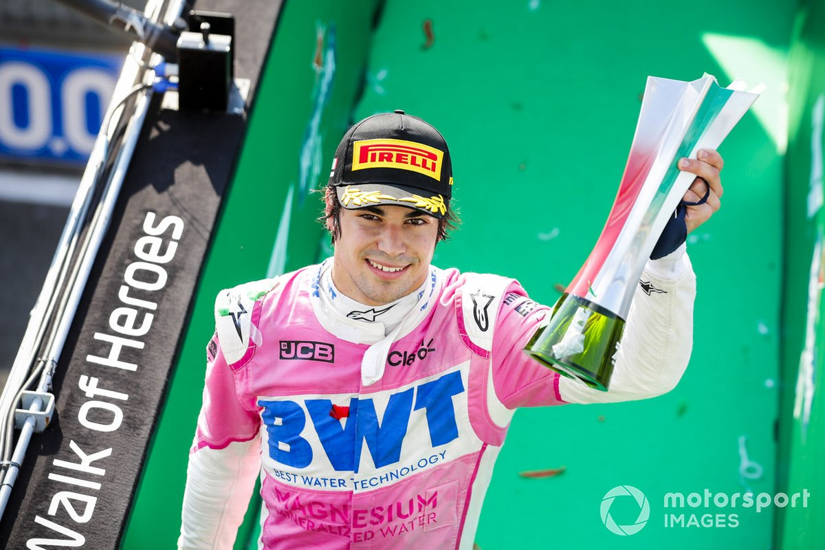 Lance Stroll, Racing Point celebrates on the podium with the chamapgne and the trophy